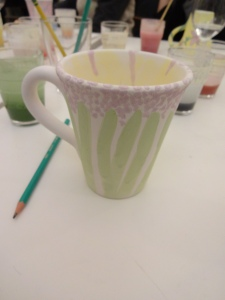 powder paint mug, inspired by a purple, bell-shaped potted flower in the room